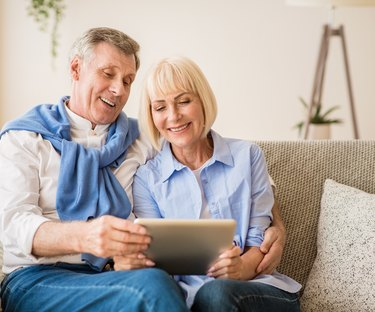 Couple looking at Tablet