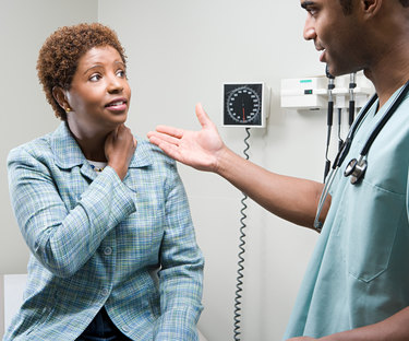 Doctor and patient discussing symptoms