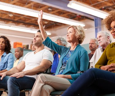 Woman asking question in neighborhood meeting